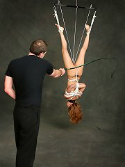 Red-haired slave girl suspended and whipped hard by her ..
