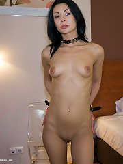 Naked MILF gets her arms and legs cuffed
