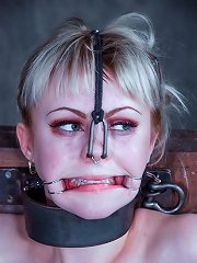 Blonde hottie gets humiliated with metal face bondage