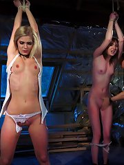 Two slaves endure whipping